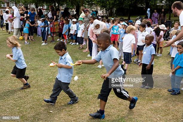 Reception Year pupils at Millfields Community School set off on an 'egg and spoon race' during their sports day held in a local park because their...