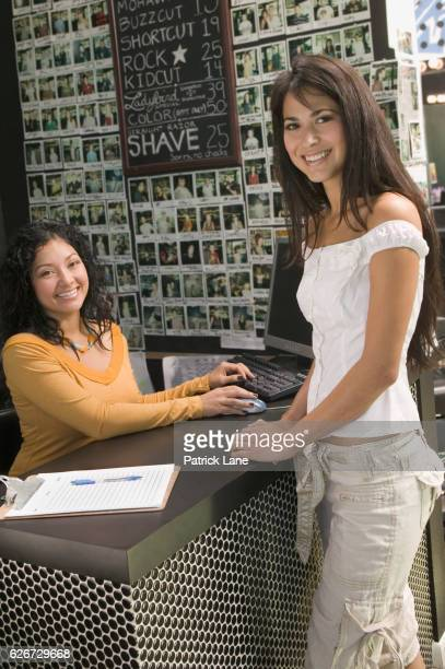 Receptionist and customer at a hair salon