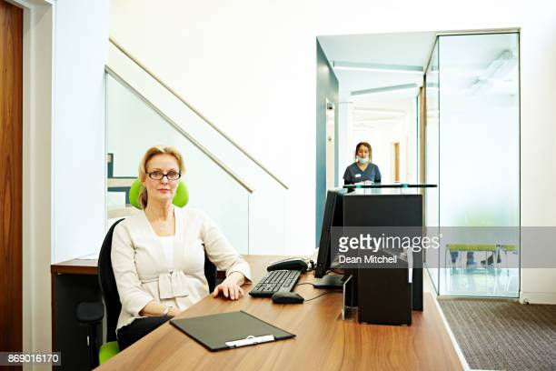 Receptionist at front desk of dental clinic