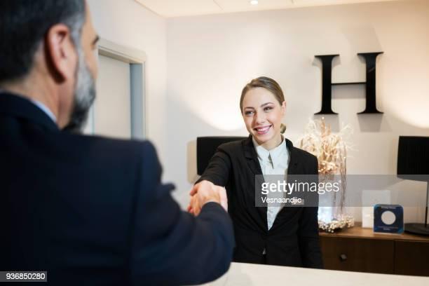 Receptionist at reception desk