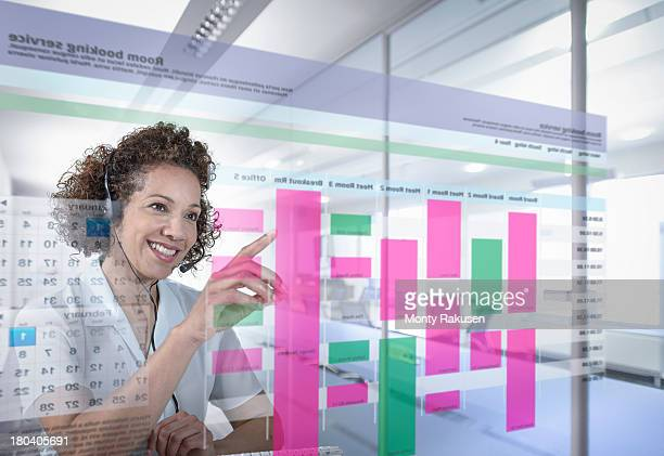 Receptionist booking meeting rooms with interactive screen