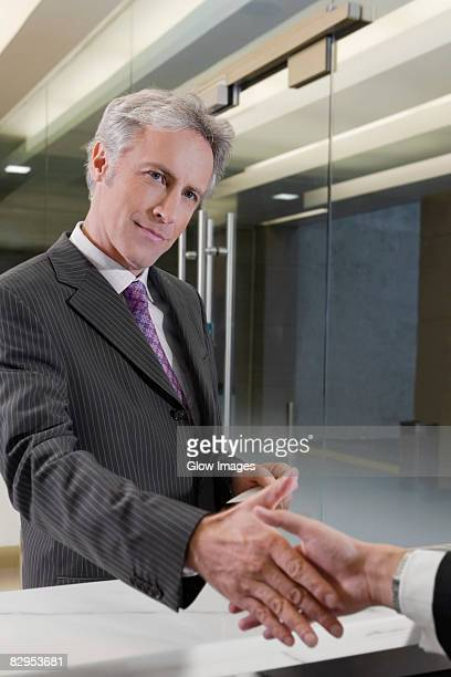 Receptionist giving the cardkey to a customer
