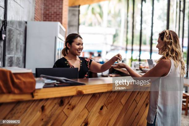 Receptionist handing over the keys to the guest on check in