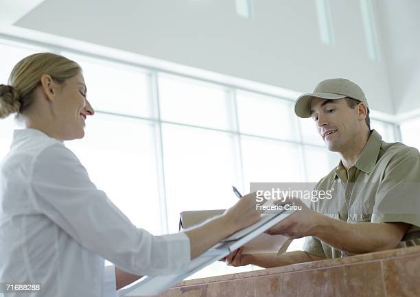 Receptionist signing for delivery