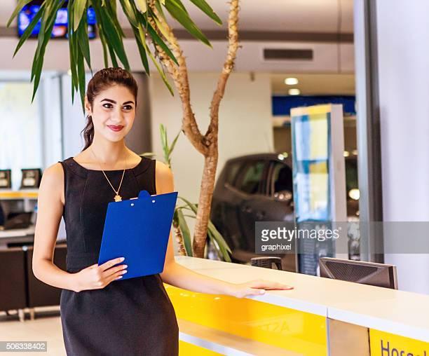 Receptionist Smiling at Information Desk
