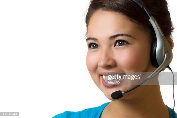 receptionist: smiling young bi racial woman with headset on white - alina stock pictures, royalty-free photos & images
