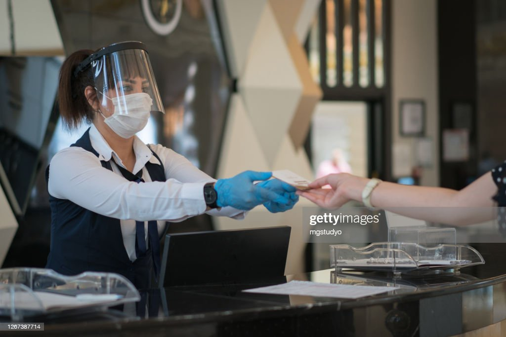 Receptionist wearing medical mask in office. Protection employees on workplace. : Stock Photo