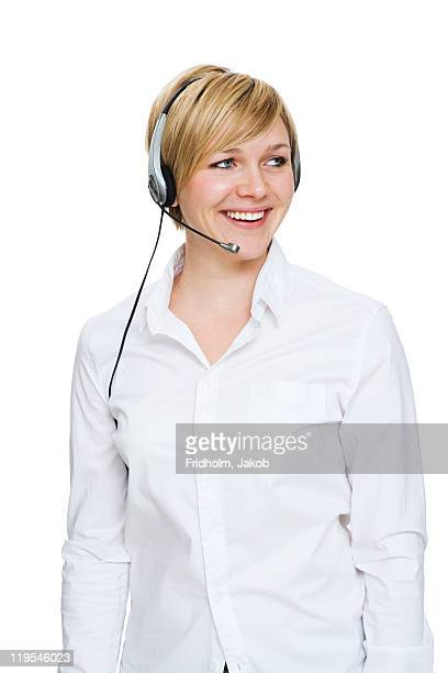 Receptionist with headphones against white background, smiling
