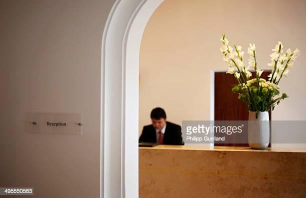 Receptionist works at Schloss Elmau, a luxury spa hotel, in the Bavarian Alps of southern Germany on June 3, 2014 in Kruen near...
