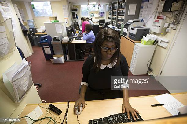 A receptionist works in a General Practitioners surgery on December 4 2014 in London England Ahead of next years general election the Chancellor of...