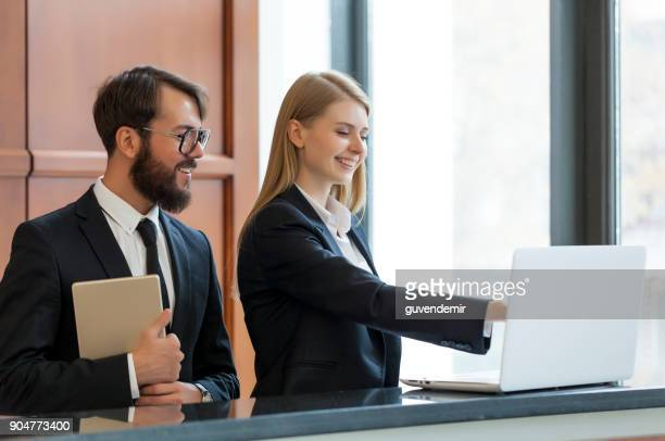 receptionists at work - hotel stock pictures, royalty-free photos & images
