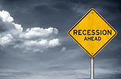 Recession ahead - road sign warning concept