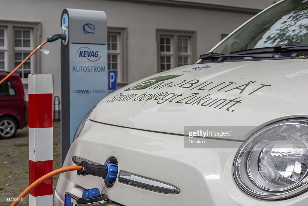 Recharging Electric Car Fiat 500 At Charging Station Stock Photo