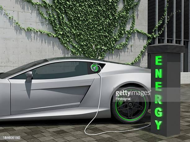 Recharging electric sport car in front of a house