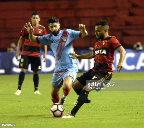 Recifes' Samuel and Arsenal's Lucas Wilchez vie for the ball during their Sudamericana Cup football match in Recife Brazil on July 6 2017 / AFP PHOTO...
