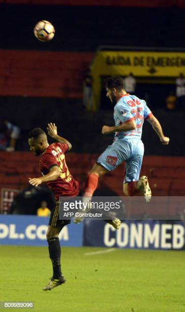 Recifes' Samuel Xavier and Arsenal's Federico Milo vie for the ball during their Sudamericana Cup football match in Recife Brazil on July 6 2017 /...