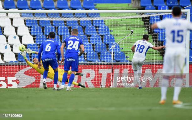 Recio of SD Eibar scores their team's first goal from the penalty spot past David Soria of Getafe CF during the La Liga Santander match between...