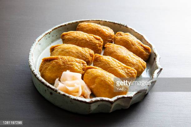 recipe for inari sushi, a traditional japanese home-cooked dish - aburaage stock pictures, royalty-free photos & images