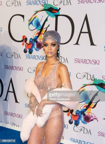 Recipient of the 2014 CFDA Fashion Icon Award Rihanna attends the 2014 CFDA fashion awards at Alice Tully Hall Lincoln Center on June 2 2014 in New...