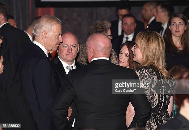 Recipient of The 2016 Intrepid Freedom Award United States Vice President Joe Biden speaks with Scott J Kelly Mark Kelly Amiko Kauderer and Gabby...