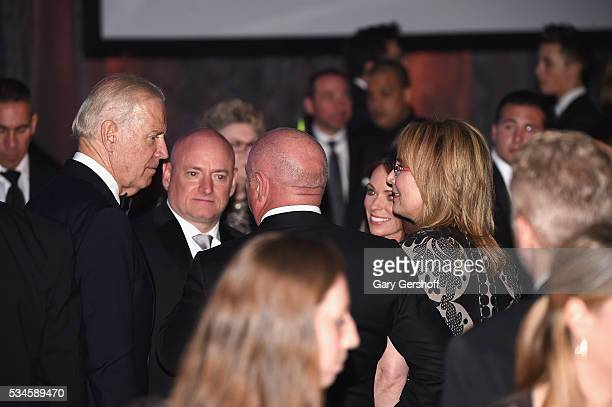 Recipient of The 2016 Intrepid Freedom Award United States Vice President Joe Biden speaks with Scott J Kelly Mark Kelly Amiko Kauderer and Gabby...