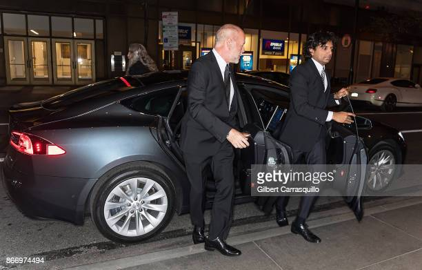 Recipient of the 2nd annual Lumiere award actor Bruce Willis and Film director M Night Shyamalan arrive in a 2017 Tesla Model S 100D Sedan at the 2nd...