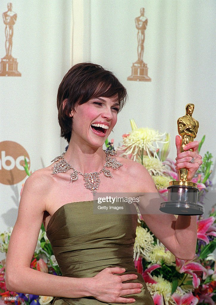 Recipient of the Best Actress Award, Hilary Swank, poses backstage of the Academy Awards with her Oscar March 26, 2000 in Los Angeles.