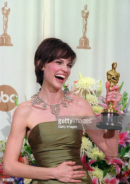 Recipient of the Best Actress Award Hilary Swank poses backstage of the Academy Awards with her Oscar March 26 2000 in Los Angeles