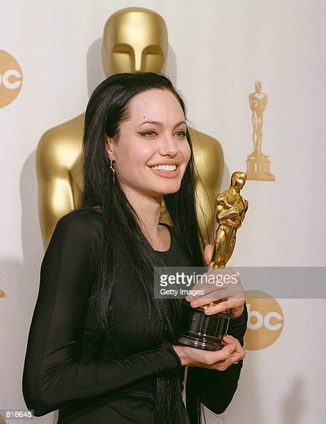 Recipient of the Best Supporting Actress Award Angelina Jolie poses backstage at the 72nd Annual Academy Awards March 26 2000 in Los Angeles