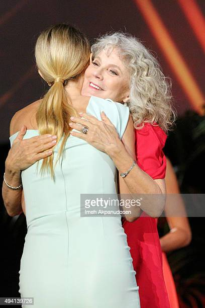 Recipient of the EMA Green Parent Award Gwyneth Paltrow and actress Blythe Danner speak onstage during the 25th annual EMA Awards presented by Toyota...