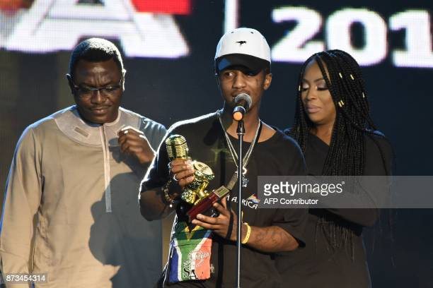 Recipient of the of Best Southern African Best Male Artist South African rap singer Emtee speaks during the All Africa Music Awards in Lagos on...