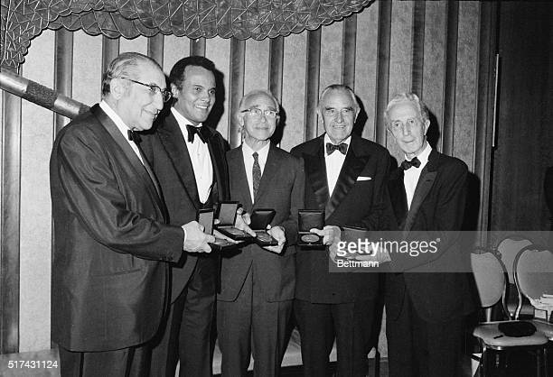Recipients of the 1972 Albert Einstein Commemorative Awards display their medallions after being honored here late on May 7th The awards are...