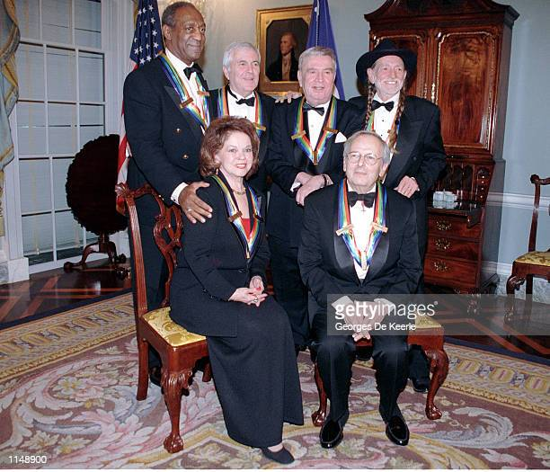 Recipients of the 1998 Kennedy Center Honors pose for a group picture December 5 1998 in Washington DC Bill Cosby John Kander Fred Ebb and Willie...