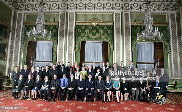 Recipients of the Duke of Edinburgh Award spanning 50 years pose for a commemorative photo at Buckingham Palace Tuesday October 19 2005 A reception...