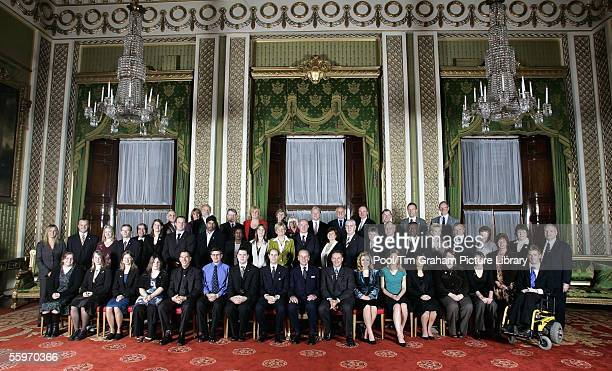 Recipients of the Duke of Edinburgh Award spanning 50 years pose for a commemorative photo at Buckingham Palace on October 19 2005 in London England...