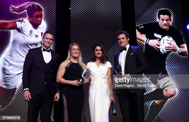 Recipients of the IRPA Special Merit Award Rachael Burford of England and Richie McCaw of New Zealand pose alongside presenter Jean de Villiers and...