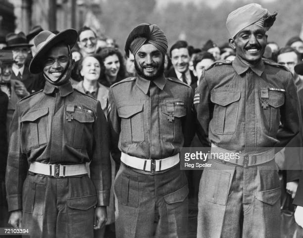 Recipients of the Victoria Cross after an investiture at Buckingham Palace 16th October 1945 Left to right Naik Bhabbhagta Gurung of the 2nd Gurkha...