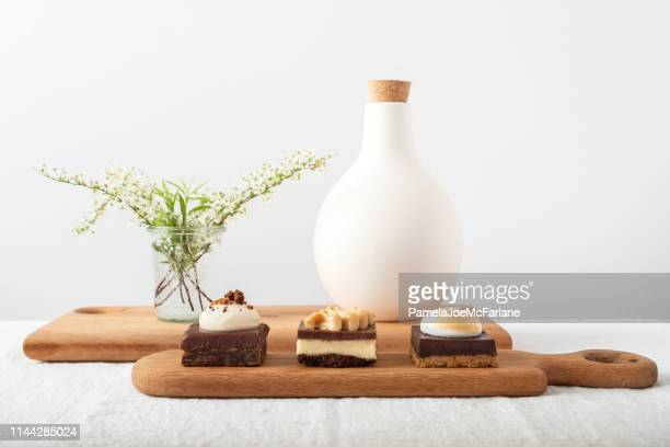 reclaimed wood serving trays with fudge, peanut butter, chocolate desserts - fudge stock pictures, royalty-free photos & images