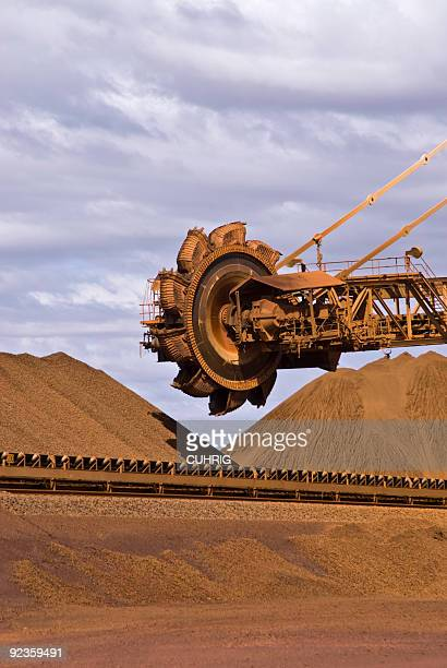 reclaimer on iron ore mine site - iron ore stock photos and pictures