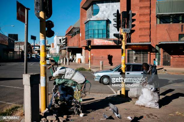 A reclaimer prepares his load of plastic waste to be brought to a recycling facility in Johannesburg on June 2 2018 On June 5 2018 the United Nations...