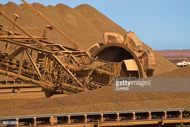 reclaimer stockpile on iron ore mine site - iron ore stock photos and pictures