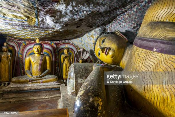 Reclined and sitting Buddhas in Dambulla cave temple