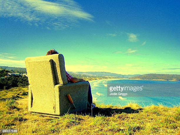 recliner chair overlooking the ocean - reclining chair stock photos and pictures