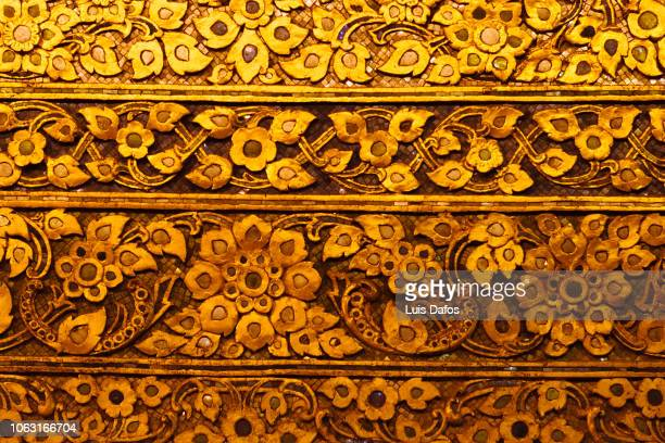 reclining buddha decorations - carving craft product stock pictures, royalty-free photos & images