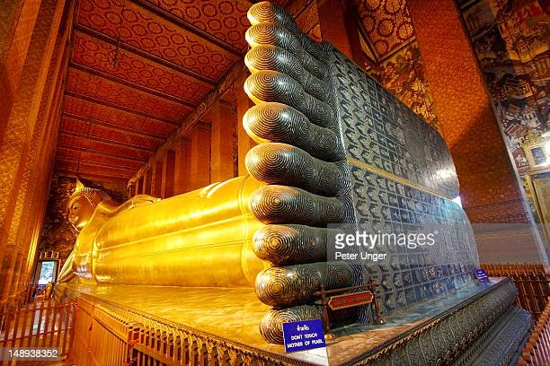 reclining buddha feet at wat pho. - wat pho stock pictures, royalty-free photos & images