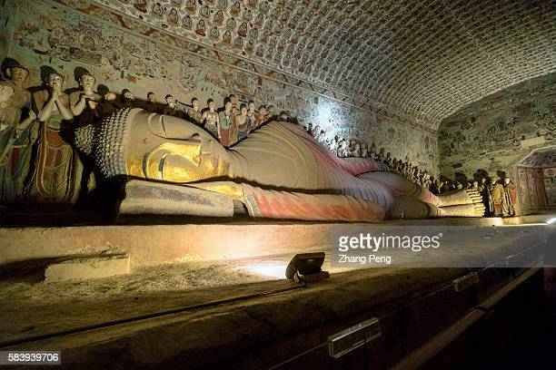 Reclining Buddha in cave 148 second largest reclining figure in Mogao Mogao Caves also known as the Thousand Buddha Grottoes are the best known of...