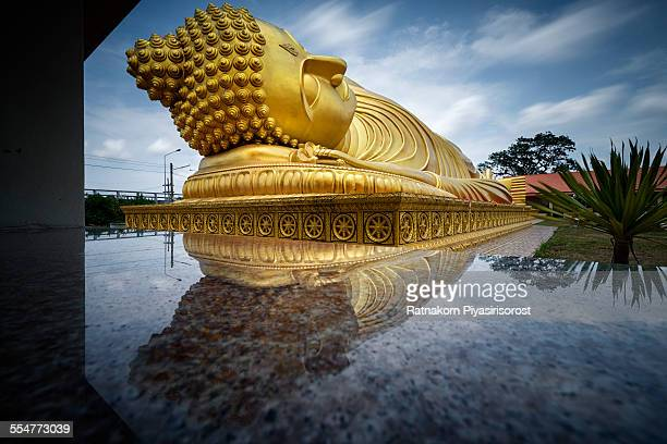 reclining buddha statu - south east asian ethnicity stock pictures, royalty-free photos & images