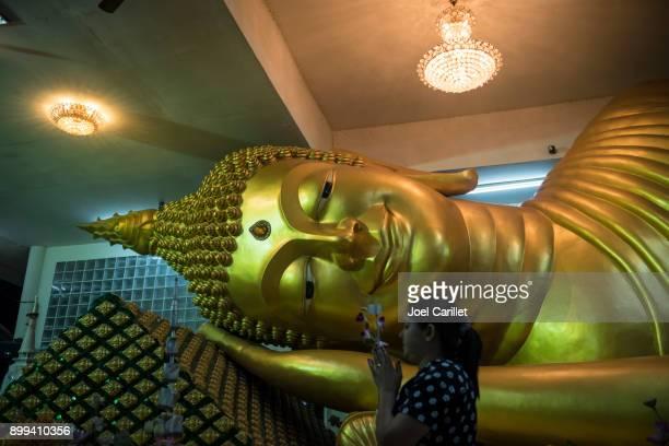 Reclining Buddha statue at Wat Vorachanyawas Pier, Bangkok, Thailand
