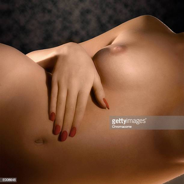 Reclining nude with red fingernails