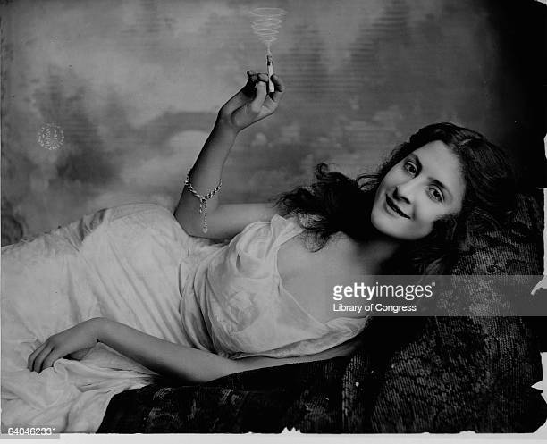 Reclining Young Woman with Cigarette